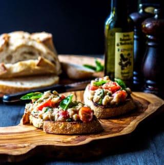 Cannellini bean and cherry tomato bruschetta (vegan).