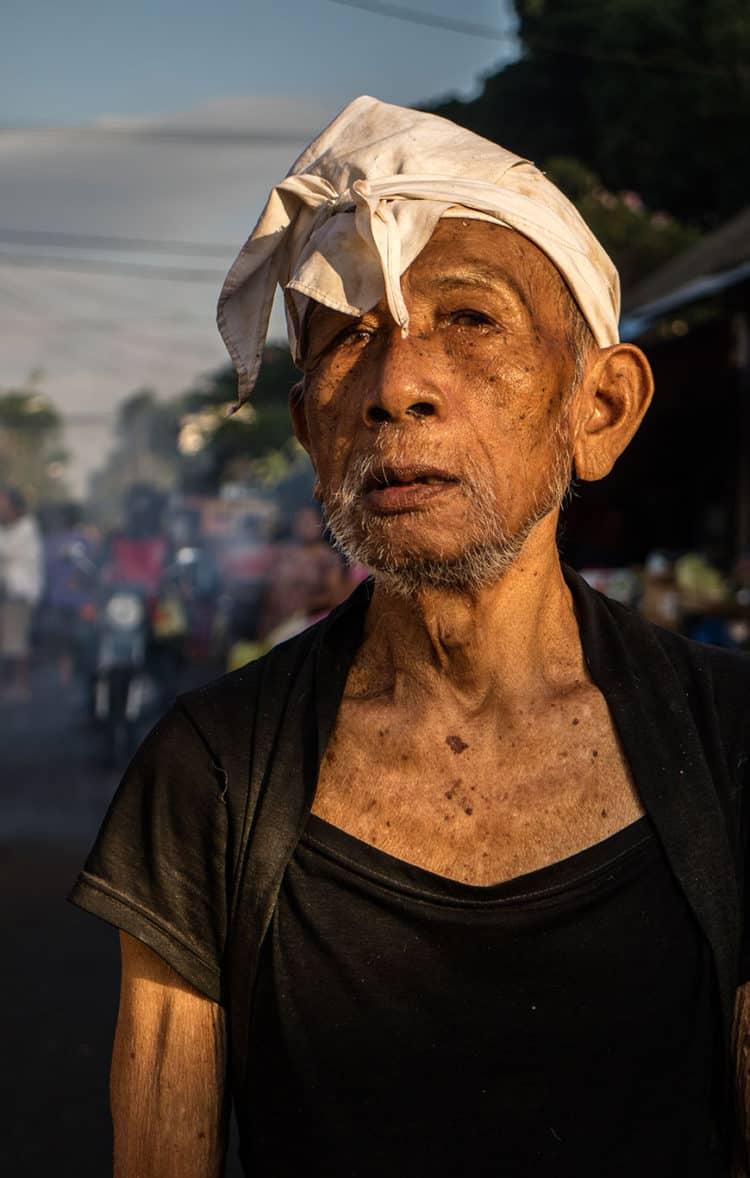 Balinese man at a market.