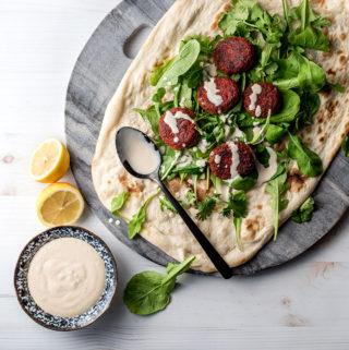 Beetroot falafel with tahini sauce.